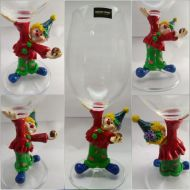 Clown glass, holding ball